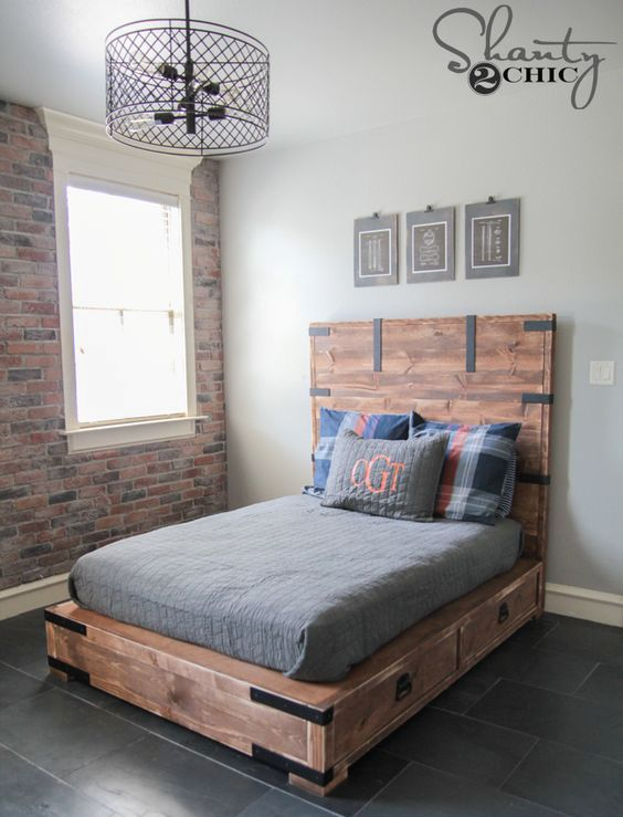 a rustic stained wooden bed with drawers in the sides is a nice piece for a rustic bedroom and it will give you much storage space