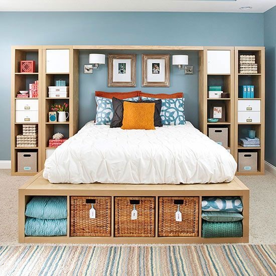 a sleek wooden bed with storage compartments at the foot - finish soem of them with woven boxes for a slight rustic feel