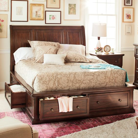 a dark stained bed with lots of drawers with knobs is a perfect piece to rock in your space