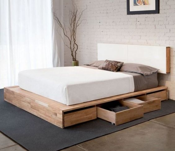 a sleek minimalist bed with invisible side drawers is a smart solution for a small space