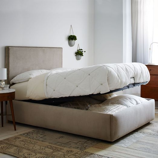 a neutral upholstered bed that can be raised to store some things inside it is an ultimate idea to rock