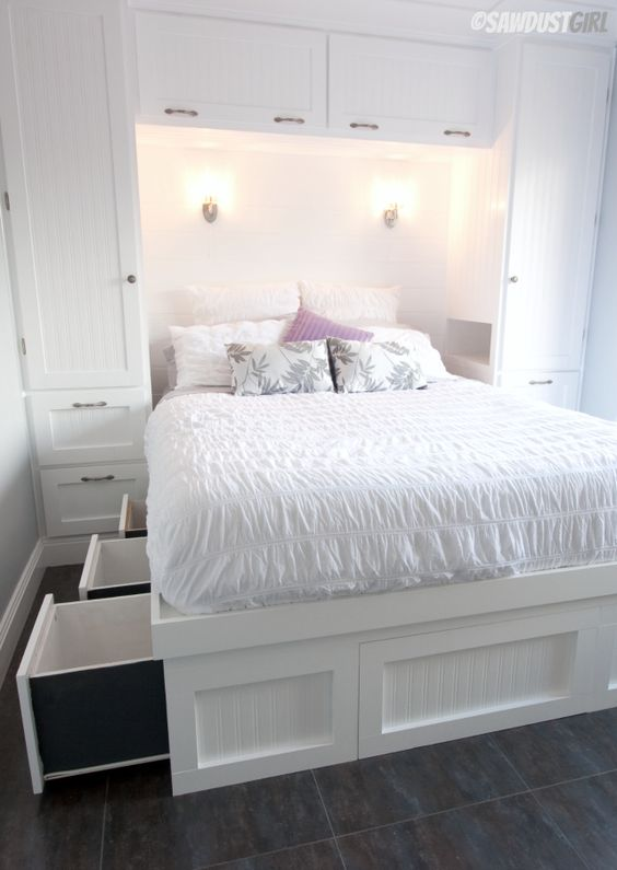a white built-in bed with storage drawers in the sides of the bed is a cool idea to go for