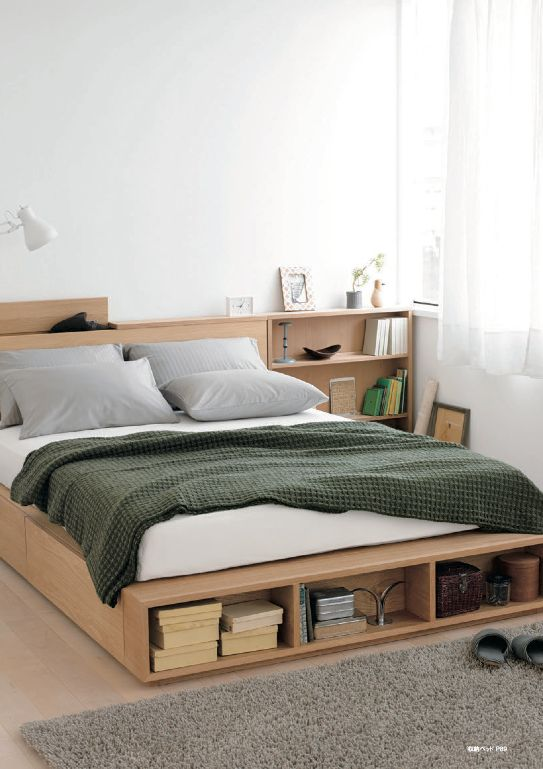 a minimalist light-stained bed with side drawers and an open storage compartment at the foot of the bed plus storage nightstands is a cool solution for a small bedroom