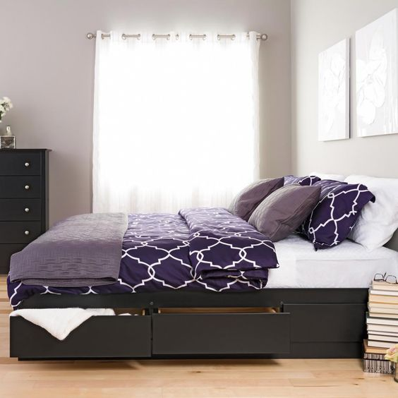 a minimalist dark stained bed with side drawers to hide various stuff you don't need at the moment