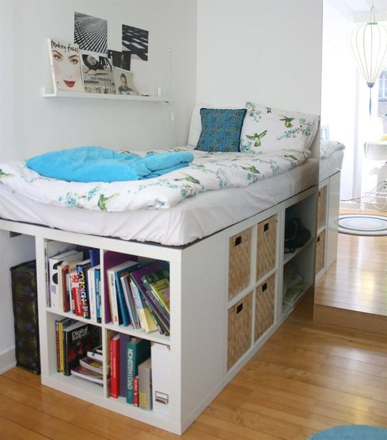 a white storage bed with lots of open storage compartments and some basket drawers is a cool option to go for