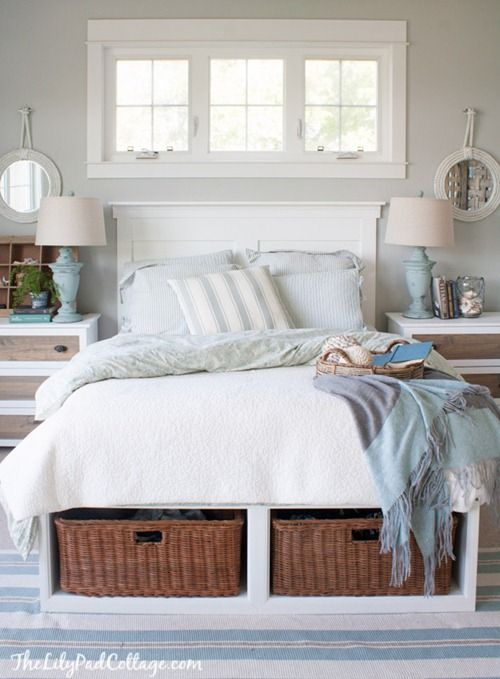 a comfy white bed with open storage compartments finished with basket drawers that add coziness and a rustic feel to the piece
