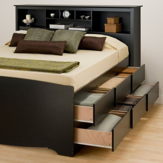 a functional black bed with a storage headboard and two levels of drawers in the sides is a cool solution to rock