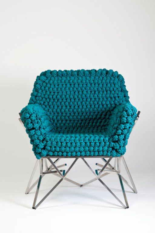 a sturdy chair with a super cozy and comfortable blue crochet cover is a bold and chic furniture piece to rock