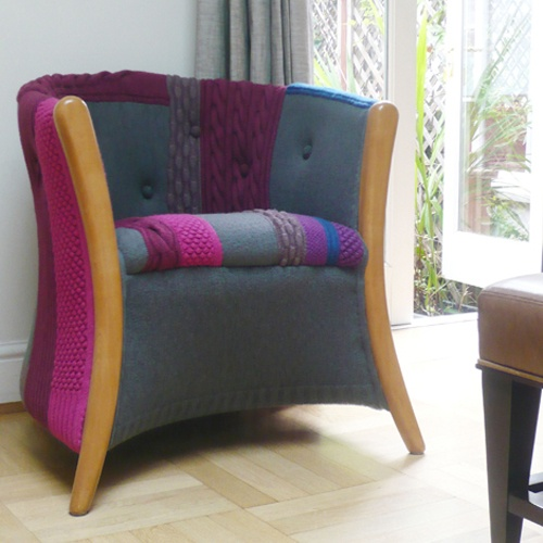 a bold chair with purple and blue crocheting integrated into its upholstery is a creative way to give a new life to an old piece of chair