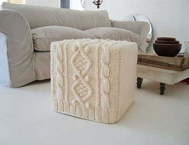 a white knit ottoman will give a touch of coziness to the space and make it more welcoming and winter ready