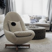 an egg-shaped chair with a knit cover is a very nice piece to make your space ready for cold months