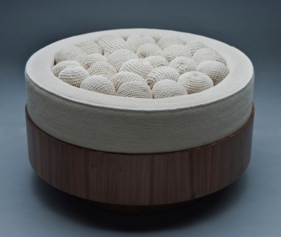 a round seat filled with crocheted balls is a whimsy and non typical piece of furniture to rock