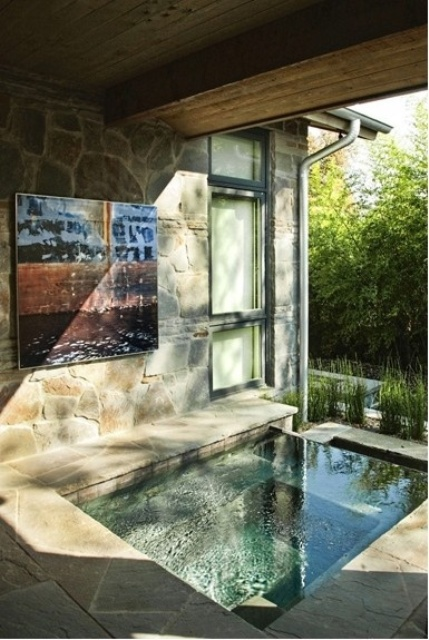 a sunken stone bathtub under a roof will help you avoid excessive sunlight and rain if any