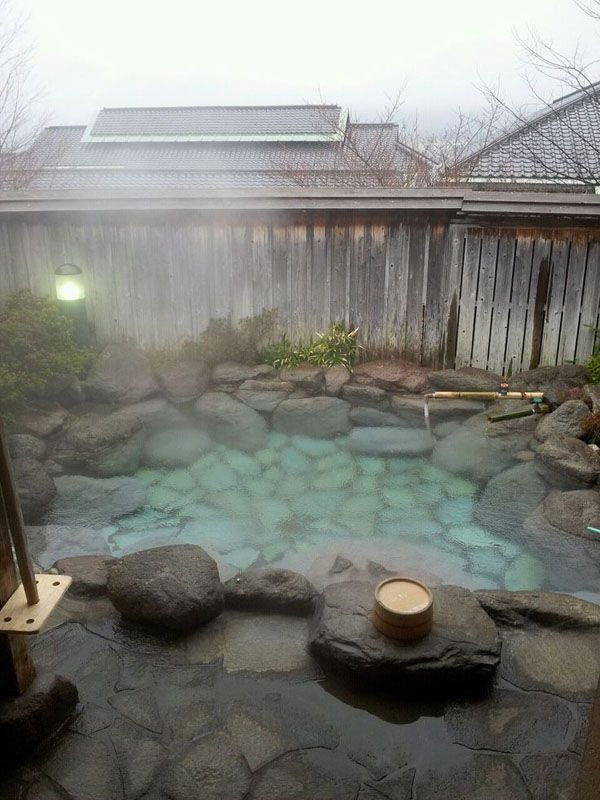 an outdoor hot tub designed with natural stones and rocks   even if there's no hot spring, you can make such a tub yourself
