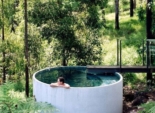 an outdoor plunge pool with tiles is a stylish thing that doesn't require much space