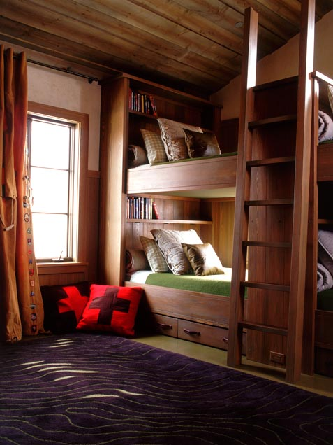 Cozy shared kids room with natural wood all around.