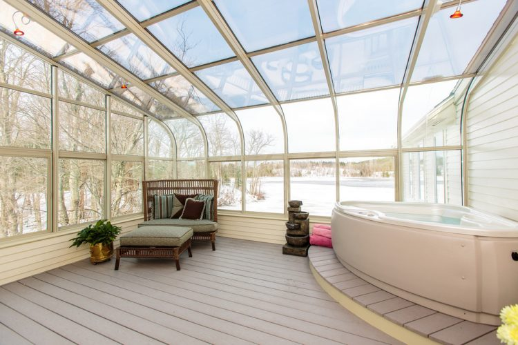 spacious four seasons sunroom with skylight and jacuzzi
