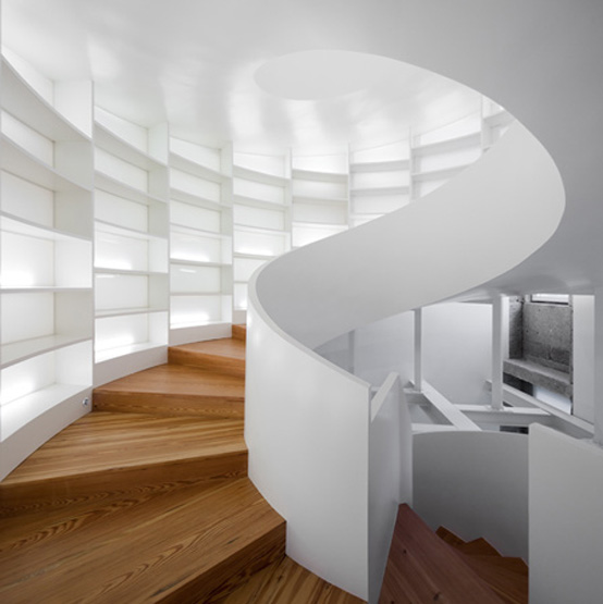 this spiral staircase not only connects two floors but also provides
