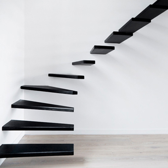 This minimalist steel staircase links the living room in the French ...