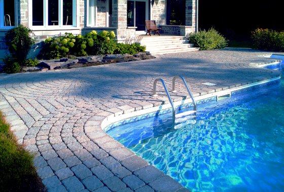 25 stone pool deck design ideas digsdigs for Pool design photos