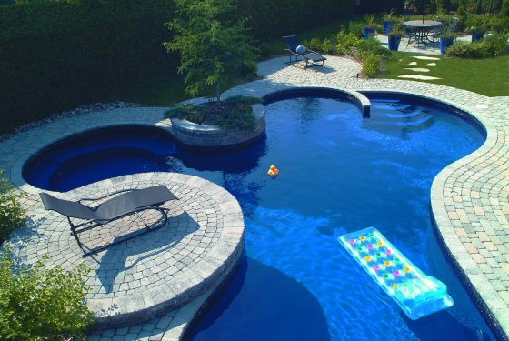 25 stone pool deck design ideas digsdigs for Swimming pool plan layout