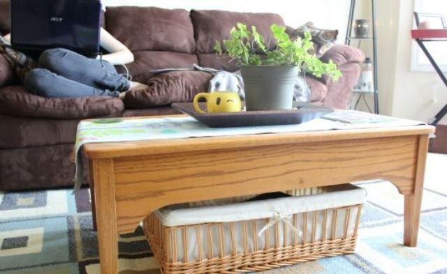 a lwo wooden coffee table with a basket for storage is a cool and cozy rustic idea