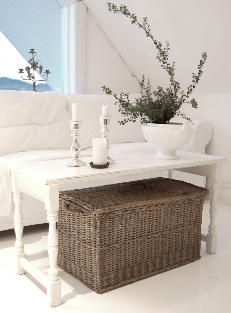 place a large woven box under the table to use it for closed storage comfortably
