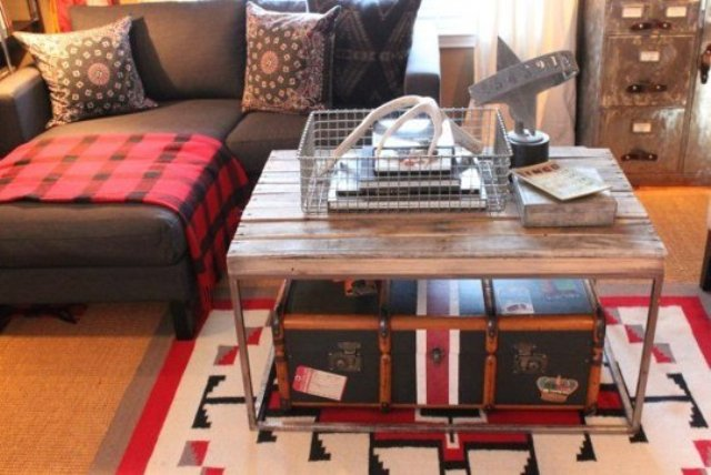 a rustic coffee table and a vintage suitcase inside it to use it for storage and as decor