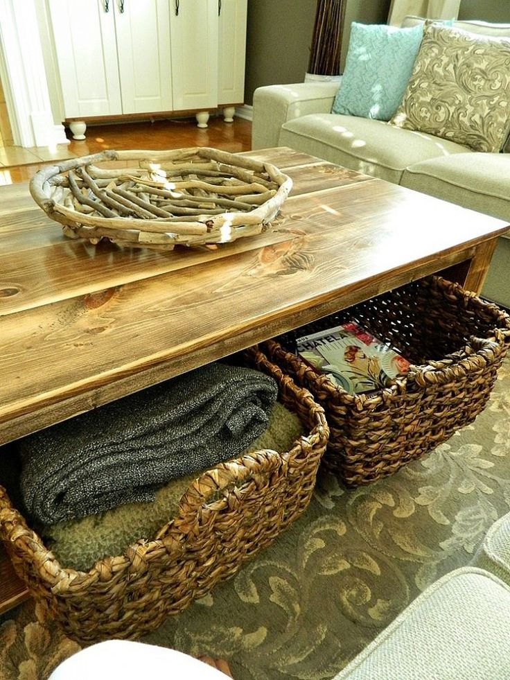 a wooden coffee table with a niche inside and basket drawers to store everything you may want