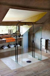 a minimalist industrial bathroom done with concrete and wood, with a skylight, a catchy shower soace and a concrete vanity with an orange sink