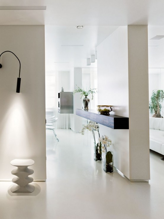 Striking minimalist living space in white yellow and dark for Flurgestaltung modern