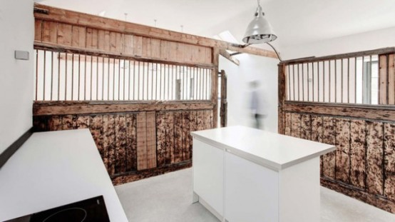 Striking Stable Conversion With Old Wooden Beams Left
