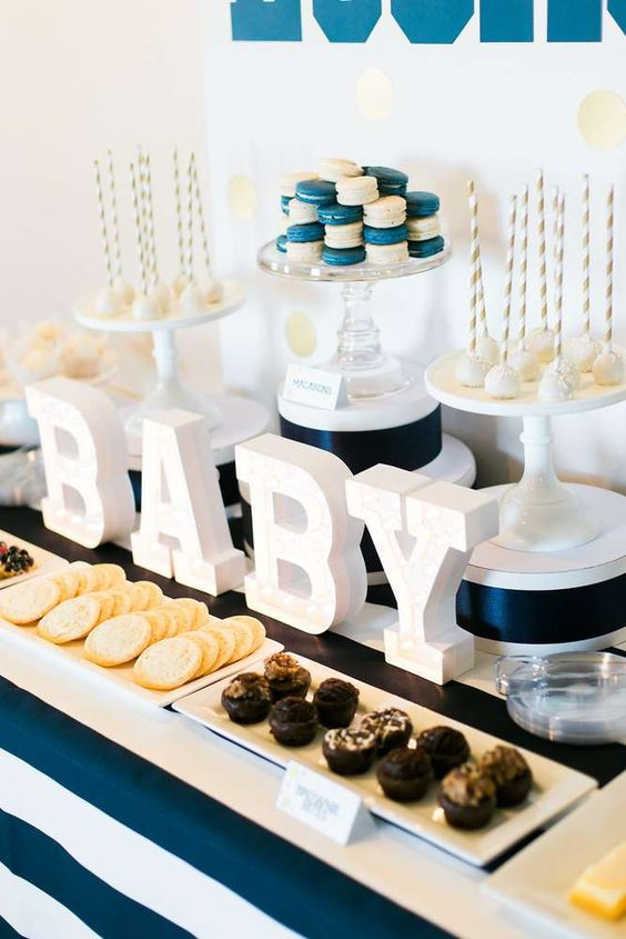 striped navy dessert table for a boy baby shower
