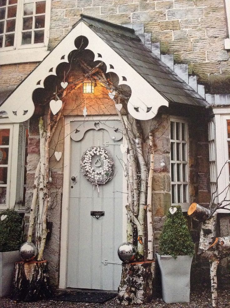 tall branches framing the door, hearts, oversized silver ornaments and a cotton wreath with twigs for a whimsy look