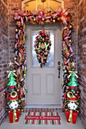 a super colorful garland to contour the door – bright ribbons, ornaments, letters, musical instruments and colorful trees