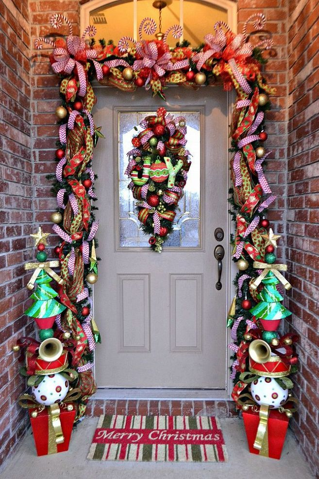 a super colorful garland to contour the door   bright ribbons, ornaments, letters, musical instruments and colorful trees