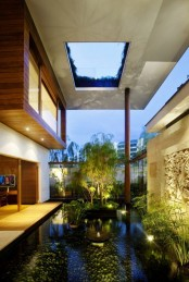 a whole water garden indoors – with a pond, lots of plants, artworks and some lights to accent it is a very zen space