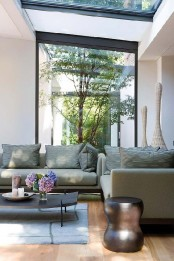 an indoor courtyard with a couple of trees growing here is a very good idea for a contemporary space to enliven it