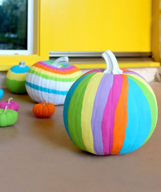 bold and colorful striped neon pumpkins are amazing for decorating a space for Halloween and look gorgeous