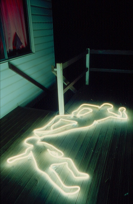 neon lights on the porch showing off some human corpses is a cool and modern idea for outdoor Halloween decor