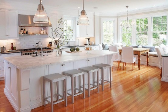 Stunning White Kitchen With A Corner Sofa And Smart Storage