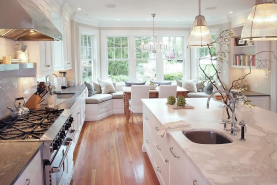 Stunning White Kitchen With A Corner Sofa And Smart Storage