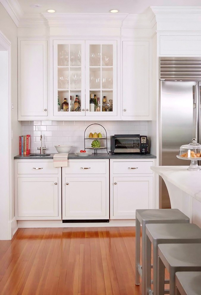 Stunning White Kitchen With A Corner Sofa And Smart Storage Digsdigs