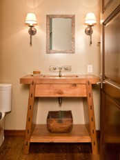 a simple stained wooden vanity with a built-in sink is a stylish idea for a rustic bathroom
