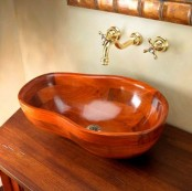a rich-stained wooden vanity paired up with a wooven sink of a whimsical shape is a cool idea for a modern bathroom