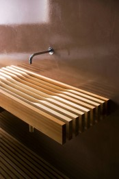 a very eye-catchy light stained wooden slab wall-mounted sink is a very unusual and very creative idea