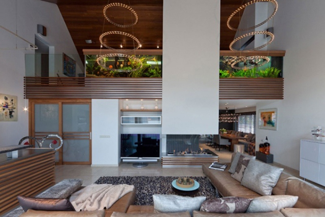 Stylish And Dramatic Apartment With A Big Aquarium