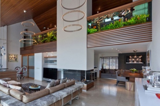 Stylish And Dramatic Apartment With A Big Aquarium