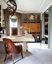 an eclectic shared home office with two white desks, chic wood chairs, a wooden chandelier and a wooden storage unit