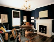 a stylish masculine home office with navy walls, a fireplace, a plaid sofa and curtain, a refined wooden desk